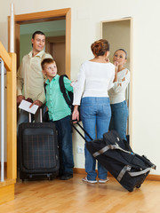 family  with luggage  going on holiday