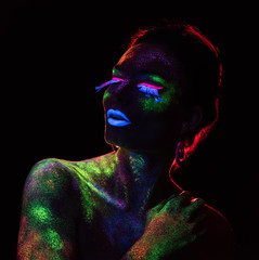 Red  light contour on the sensual woman with fluorescent paint