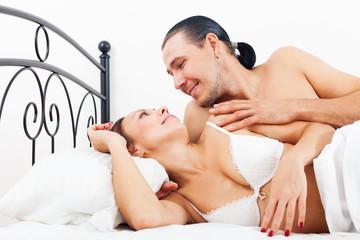 Loving adult couple awaking together