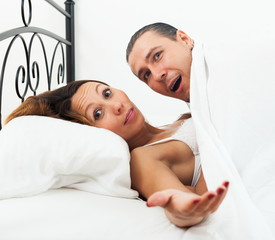 Amazed lovers in bed