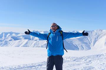 Happy hiker in winter