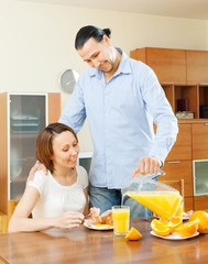 couple having breakfast with juice in motning
