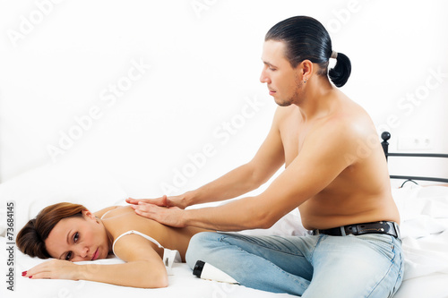 Man does massage to his wife Poster
