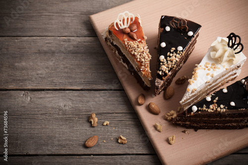 Foto op Aluminium Dessert cake on old wooden background