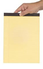 Hand Holding Blank Legal Pad