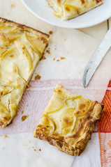 hot fresh flaky apple pie on a wooden table