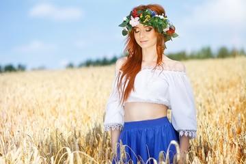 Redhead girl in a field of rye