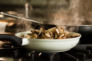 Preparation of shitake dish on stove