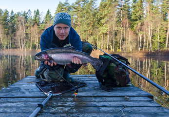 Happy angler with big November trout