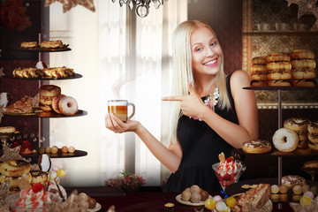 Bakery. Happy Saleswoman with Cup of Coffee in Bakeshop