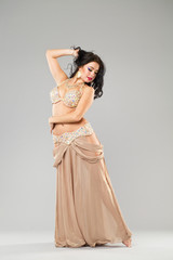 Portrait of the young sexy woman in long arabic skirt