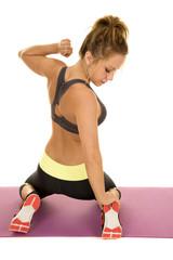woman fitness sports bra kneel back look down