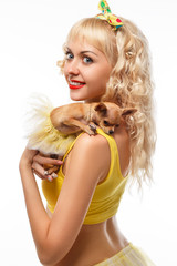 Beautiful glamour woman with small dog Chihuahua in hands