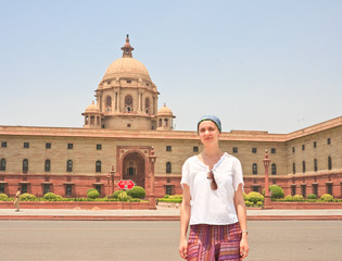 A tourist on the esplanade Rajpath. The Indian government buildi