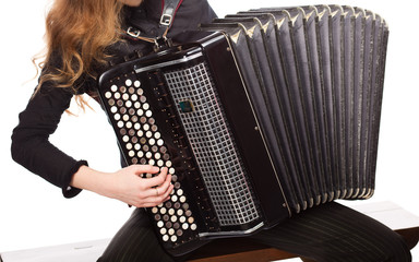 Musician playing accordion, isolated on white