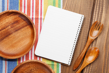 Wood kitchen utensils with notepad for copy space