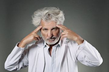 White hair scientist deeply focused
