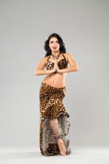 Portrait of the young sexy woman in leopard skirt