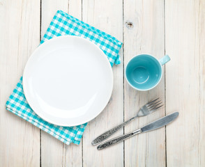 Empty plate, cup and silverware