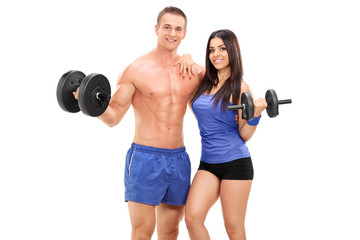 Couple of athletes posing with metal weights