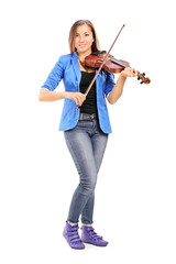 Young female artist playing a violin