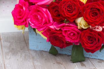 red, yellow  and pink  roses  on table