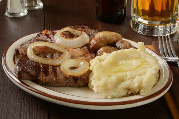 Steak and potatoes with beer