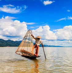 Myanmar fisherman with traditional style at Inle lake