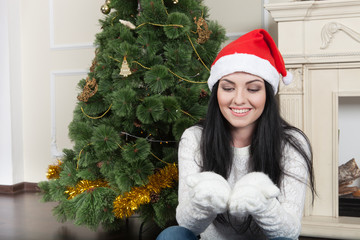 Happy woman wearing a Christmas hat