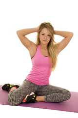 woman pink sports top sit hands in hair