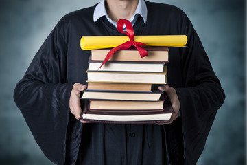 graduate with books and diploma