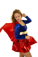 woman super hero red cape blowing look back