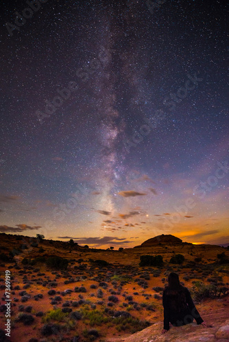 Girl Sitting on the rock looking at the Milky Way - 73691919
