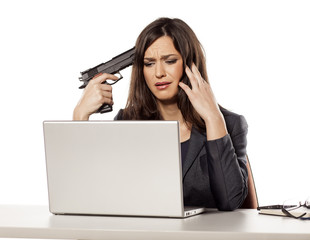 weeping young businesswoman wants to kill herself with a gun