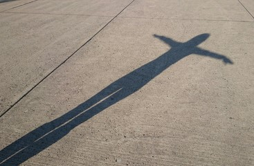 Shadow woman cross