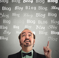man has idea pointing looking up copy space with blog words