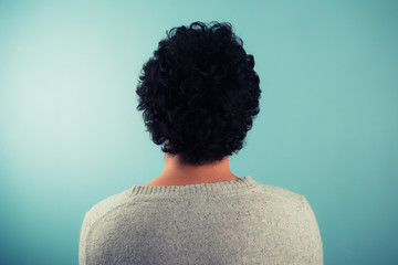 Rear view of man with curly hair