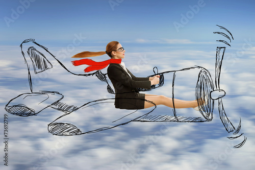 aviator woman with scarf and glasses flying designed airplane - 73692799