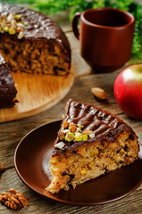 cake with nuts, chocolate chips and chocolate glaze