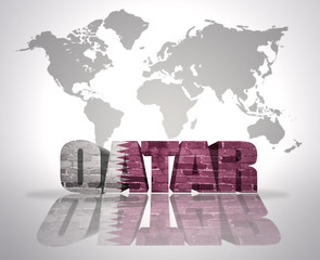 Word Qatar on a world map background
