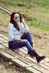 Fashion portrait of a beautiful young woman outdoor