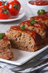 Meatloaf with ketchup closeup, vertical