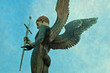 Male angel statue with sword with background texture