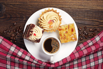 Plate with tasty cakes and coffee