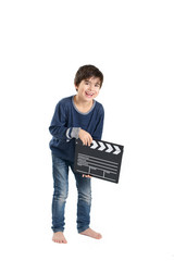 Cute boy is laughing keeping clapperboard