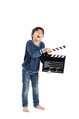 A bare-feet boy laughing keeping clapperboard