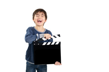 Boy holding black clapperboard