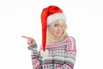 A cute woman in Santa's hat pointing right with finger