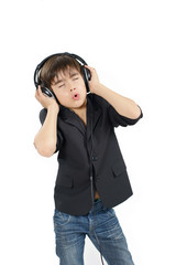 Cute darkhaired boy is listening to music in a headset