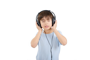 Cute boy is listening to music with eyes closed
